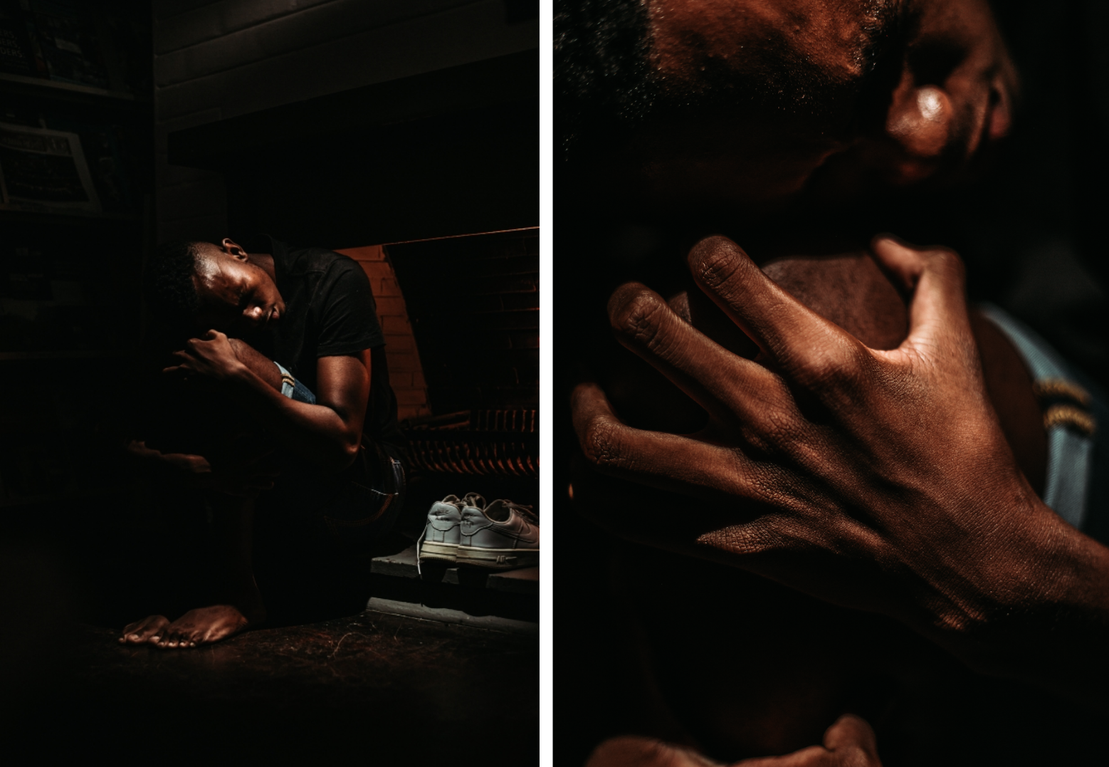 Young man crouches in a dark corner of a room hugging his knees, eyes closed