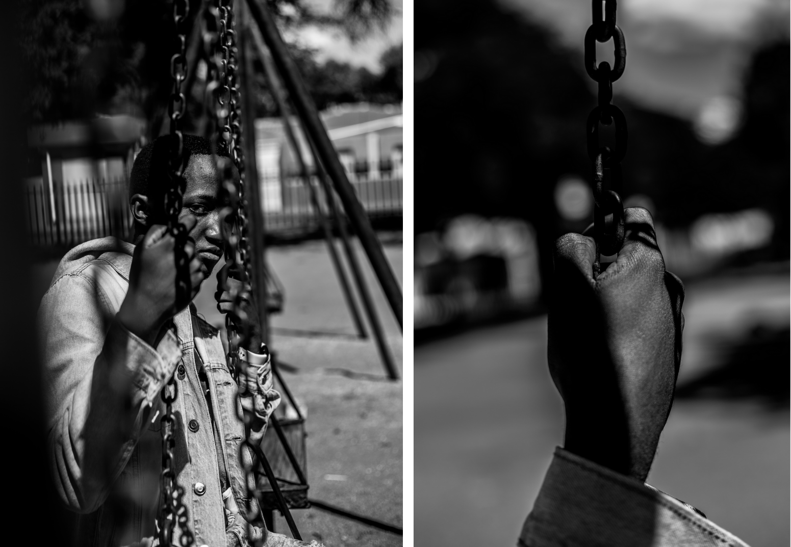 Young man sits alone on a swing, his hand gripping the chains either side of his face
